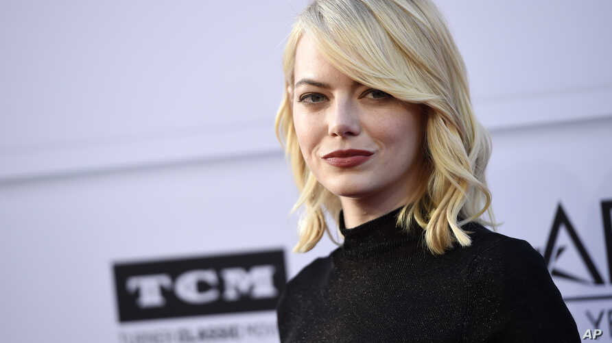 Actress Emma Stone poses at the 45th AFI Life Achievement Award Tribute to Diane Keaton at the Dolby Theatre, June 8, 2017, in Los Angeles.