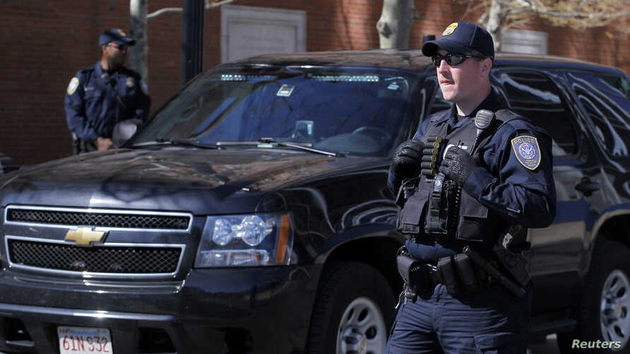 Homeland Security officers stand guard outside of John Joseph Moakley United States Courthouse in Boston, Massachusetts May 1, 2013.