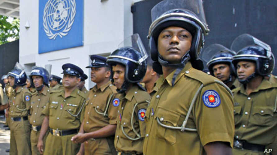 Police officers stand guard in front of the UN head office during a protest in Colombo, Sri Lanka, March 2, 2012. The UN Human Rights Council is currently debating a proposed resolution to probe alleged war crimes in the final months of the Sri Lanka