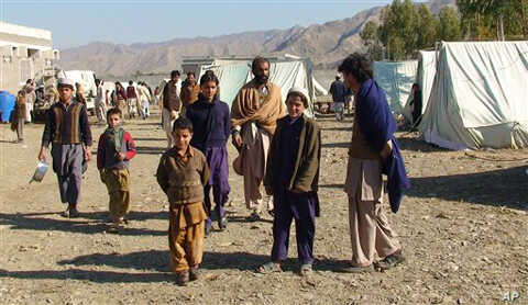 In this photo taken on Jan. 31, 2011, displaced Pakistanis arrived at a camp set up in Naghi, 18 kilometers northwest of the Afghanistan border in the Pakistani tribal area of Mohmand.