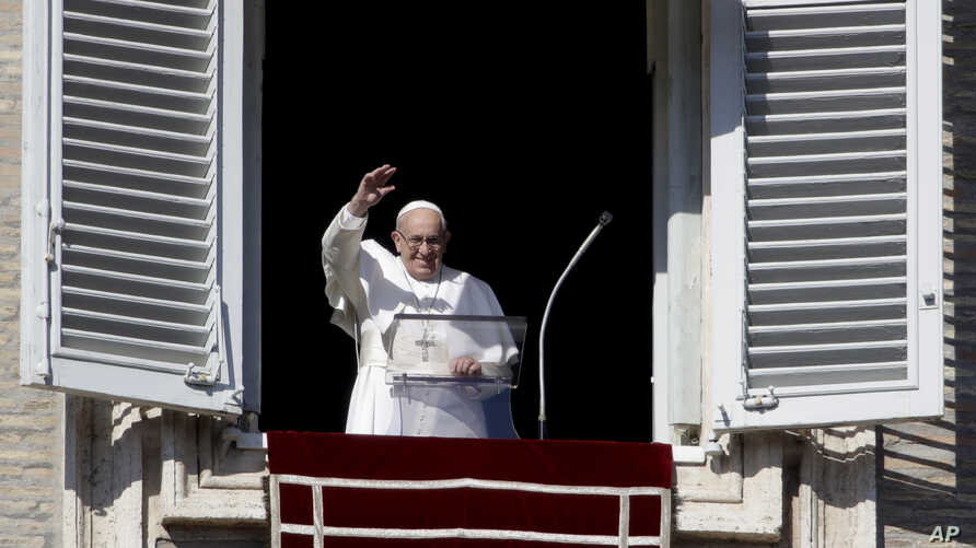 Pope Francis waves as he arrives to recite the Angelus noon prayer from the window of his studio overlooking St.Peter's Square, at the Vatican, Sunday, Nov. 11, 2018.