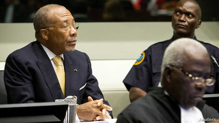 Former Liberian President Charles Taylor appears in court at the Special Court for Sierra Leone for his appeal judgment at The Hague in the Netherlands, Sep. 26, 2013.
