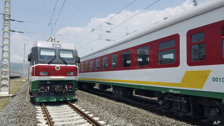 FILE - In this photo of Saturday, Sept.24, 2016, locomotives for the new Ethiopia to Djibouti electric railway system queue outside a train station in the outskirts of Addis Ababa. One of Africa's best-performing economies on Wednesday launched its l