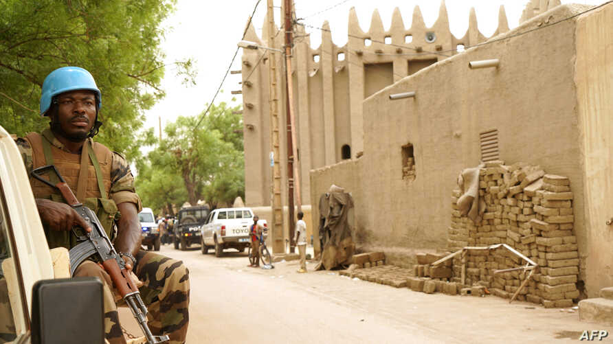 FILE - A peacekeeper with the United Nations patrols outside the mosque in Mopti, central Mali, May 30, 2018.