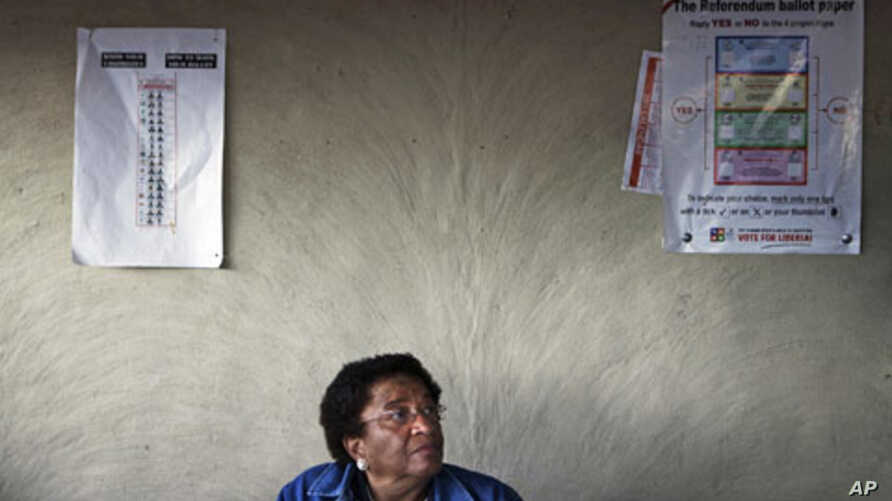Nobel Peace Prize Laureate and incumbent leader Ellen Johnson-Sirleaf sits at a resident's home after voting during presidential elections at her home village of Fefee outside the capital Monrovia, Liberia, November 8, 2011.