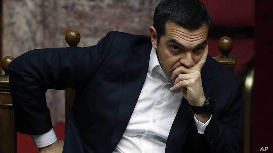 Greece's Prime Minister Alexis Tsipras joins a parliament session in Athens, Feb. 8, 2019. Greek lawmakers became the first to ratify Macedonia's NATO accession, ending a process to normalize relations between the two neighbors and anchor the country