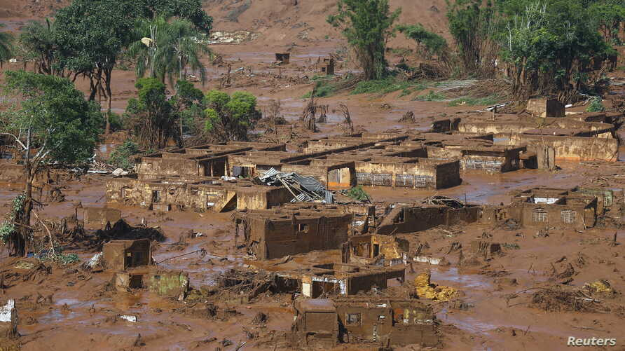FILE - The Bento Rodrigues district is pictured covered with mud after a dam owned by Vale SA and BHP Billiton Ltd. burst in Mariana, Brazil, Nov. 6, 2015.