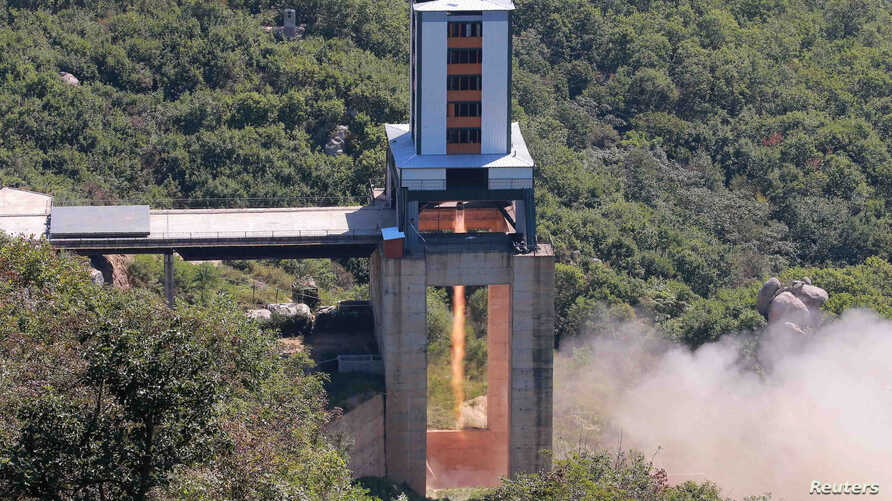 FILE - A demonstration of a new rocket engine for the geo-stationary satellite at the Sohae Space Center in this undated photo released by North Korea's Korean Central News Agency in Pyongyang, North Korea, Sept. 20, 2016.