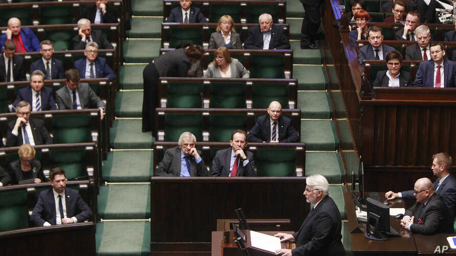 Poland's Foreign Minister Witold Waszczykowski, bottom center, delivers an anual policy speech in parliament in Warsaw, Poland, Thursday, Feb. 9, 2017.
