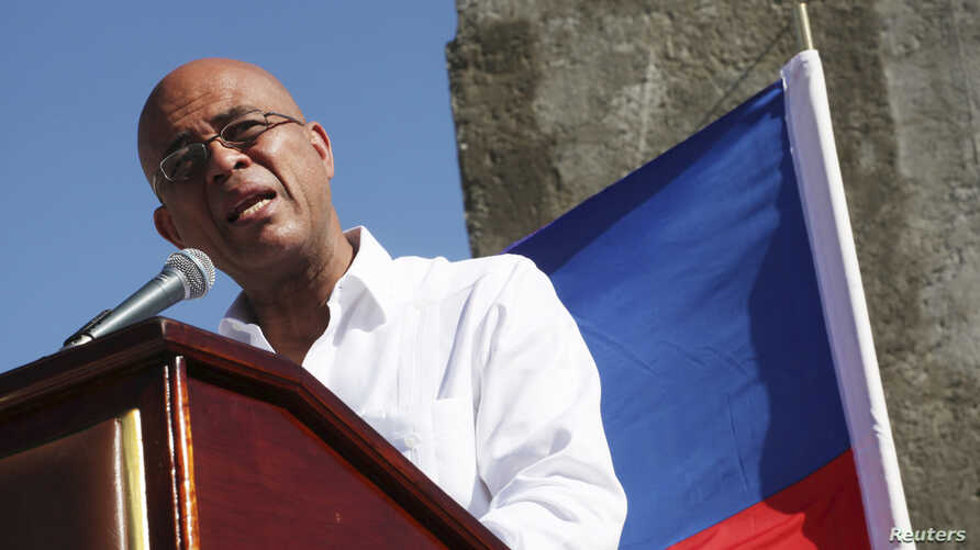 Haiti's President Michel Martelly addresses the audience during a memorial held for the victims of the 2010 earthquake in Titanyen, on the outskirts of Port-au-Prince, Jan. 12, 2015.