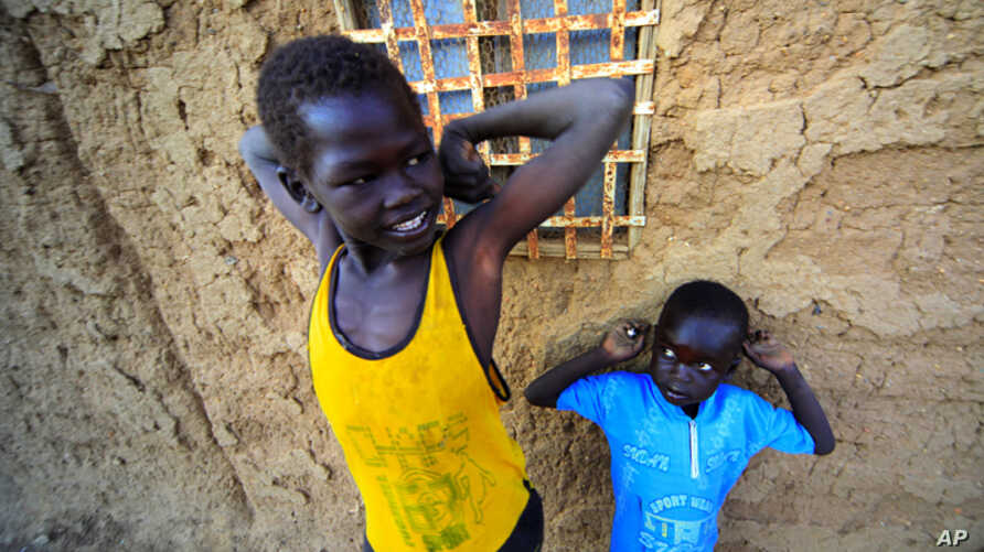 Jan. 6: Southern Sudanese boys staying in north Sudan wait at their house at the Hadj Yoasf district in Khartoum. After south Sudan votes as expected to secede from the north on Jan. 9, leaders of both countries must still resolve a daunting range of