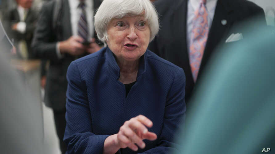 Federal Reserve Chair Janet Yellen speaks to a student at a job training center in Cleveland, Ohio, Sept. 26, 2017.