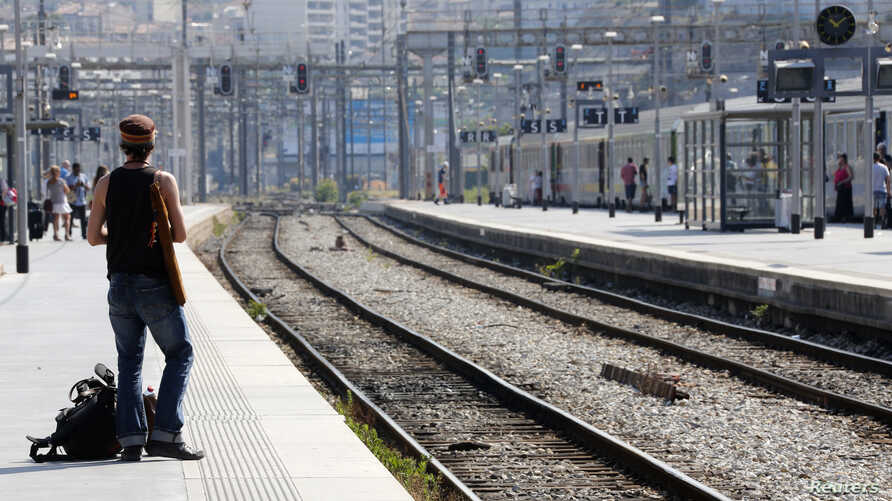 A commuter waits for a train during a nationwide strike by French SNCF railway workers at Marseille train station, June 12, 2014.