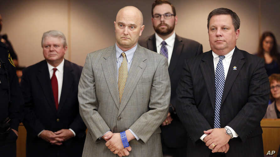 Former Balch Springs Police Officer Roy Oliver, foreground left, stands next to defense attorney Miles Brissette, right, after being sentenced to 15 years in prison for the murder of 15-year-old Jordan Edwards, Aug. 29, 2018, in Dallas.