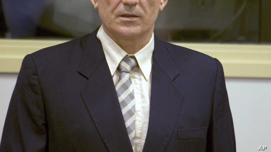 FILE - Gen. Mile Mrksic is seen during a pre-trial hearing at the War Crimes tribunal in The Hangue, Netherlands, Oct. 10, 2005.