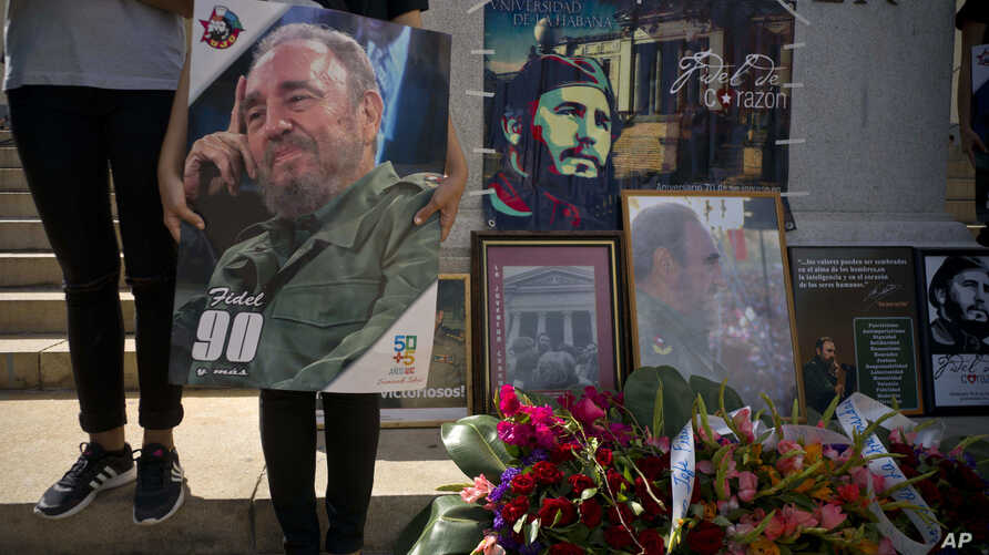 People with images of Fidel Castro gather one day after his death in Havana, Cuba, Nov. 26, 2016. Cuba will observe nine days of mourning for the former president who ruled Cuba for half a century.