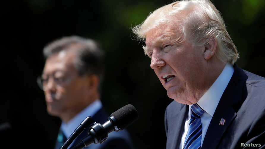 U.S. President Donald Trump (R) and South Korean President Moon Jae-in deliver a joint statement from the Rose Garden of the White House in Washington, June 30, 2017.