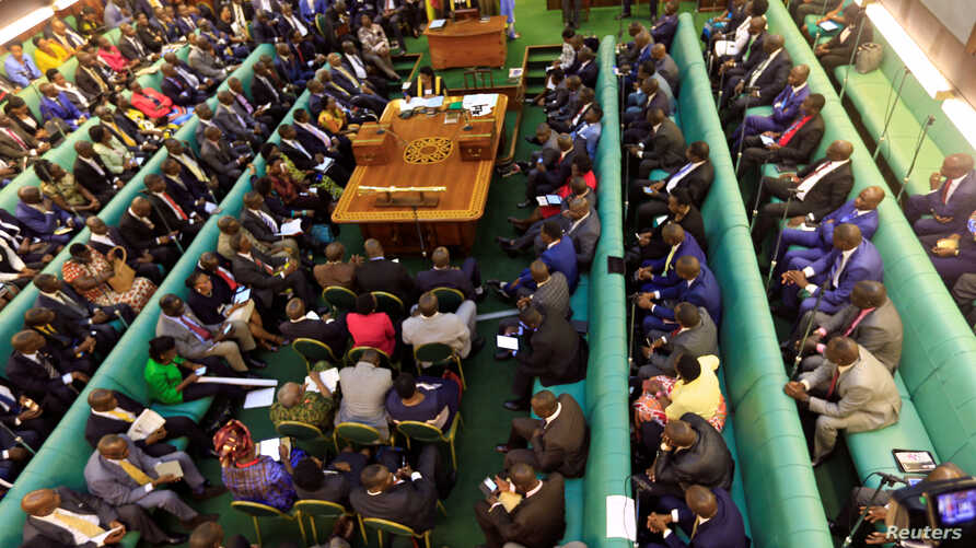 FILE - Ugandan lawmakers gather in the parliament to debate a move to change the constitution to extend the president's rule, in Kampala, Uganda, Sept. 21, 2017.