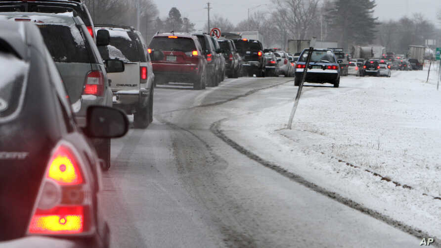 Cars are stuck in traffic as a winter storm arrives , Feb. 8, 2013 in Newington, N.H.