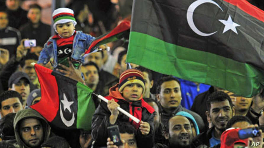 People with the Kingdom of Libya flags gather during a celebration to mark the Revolution of February 17 in Benghazi, February 16, 2012.