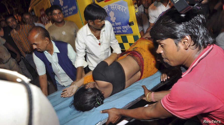 A woman who was injured in a stampede is moved to a hospital for treatment in the eastern Indian city of Patna, Oct. 3, 2014.