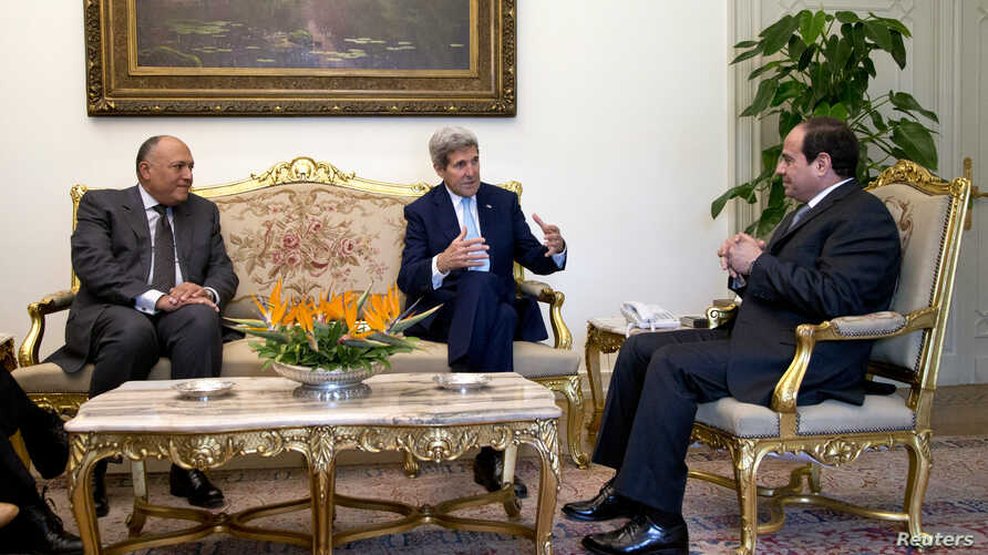 Egypt's President Abdel Fattah al-Sisi, right, and Foreign Minister Sameh Shoukry, left, meet with U.S. Secretary of State John Kerry at Cairo's presidential palace Oct. 13, 2014.