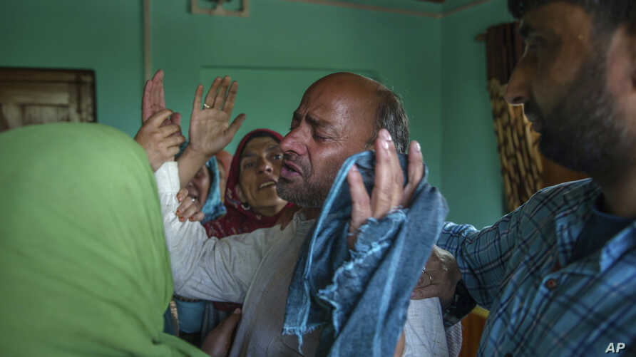 Abdul Gaffar mourns the killing of his son Manzoor Ahmed Bhat, April 6, 2018, who was abducted, and later killed by suspected militants, at his residence in Hajin, about 38 kilometers (24 miles) north of Srinagar, Indian-controlled Kashmir. Police sa