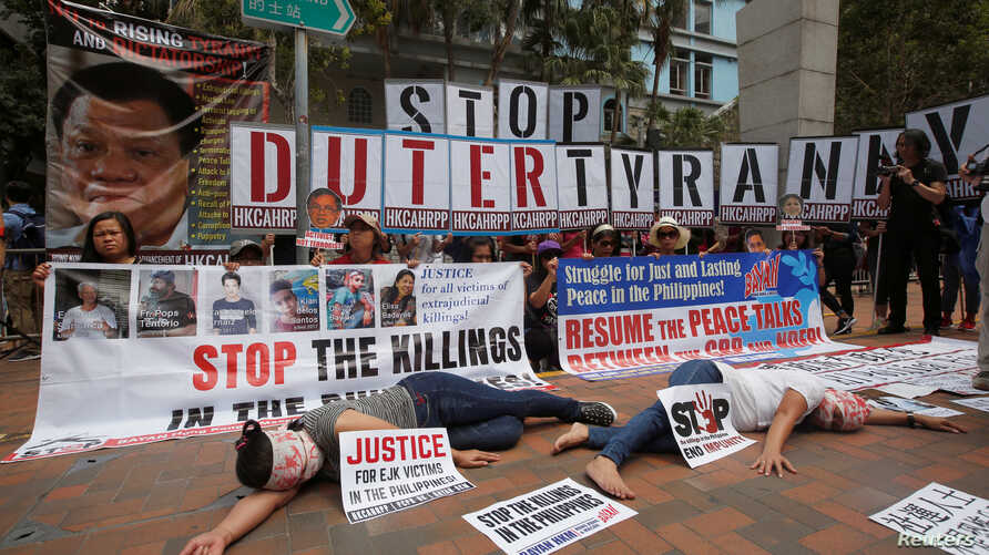 Protesters against Philippine President Rodrigo Duterte demonstrate near the hotel where he is staying at during his visit to Hong Kong, April 12, 2018.