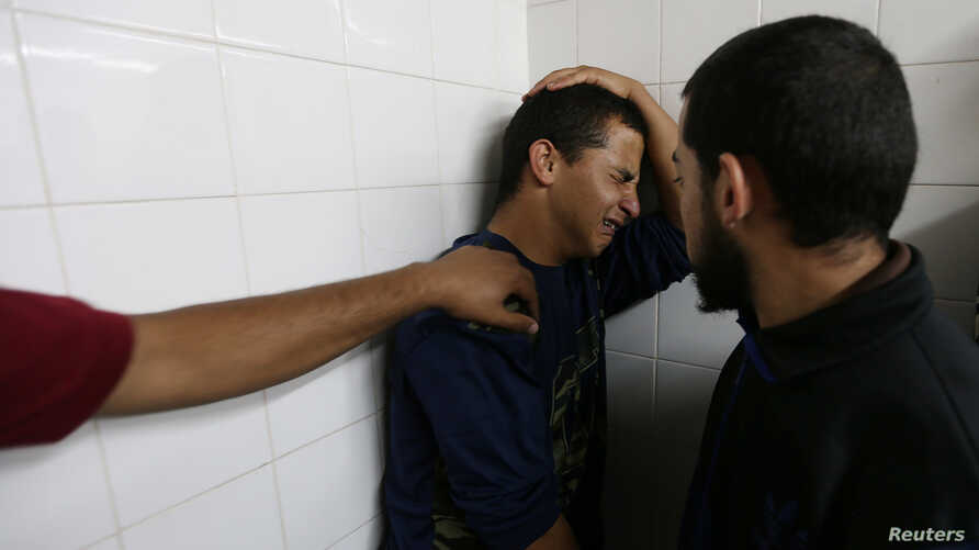 A relative of a Palestinian who was killed at the Israel-Gaza border reacts at a hospital, in the southern Gaza Strip, May 6, 2018.