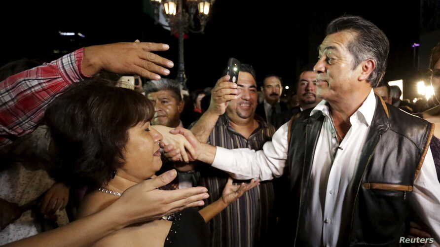 FILE - Jaime Rodriguez greets people after his swearing-in ceremony as the governor of Nuevo Leon state in Monterrey, Mexico, early on Oct. 4, 2015.