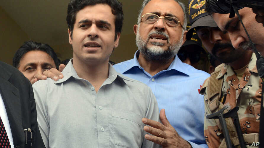 Awais Shah, center left, speaks to journalists with his father Sajjad Ali Shah, center right, chief justice of Sindh's High Court, after the son was rescued from kidnappers, in Karachi, Pakistan, Tuesday, July 19, 2016.