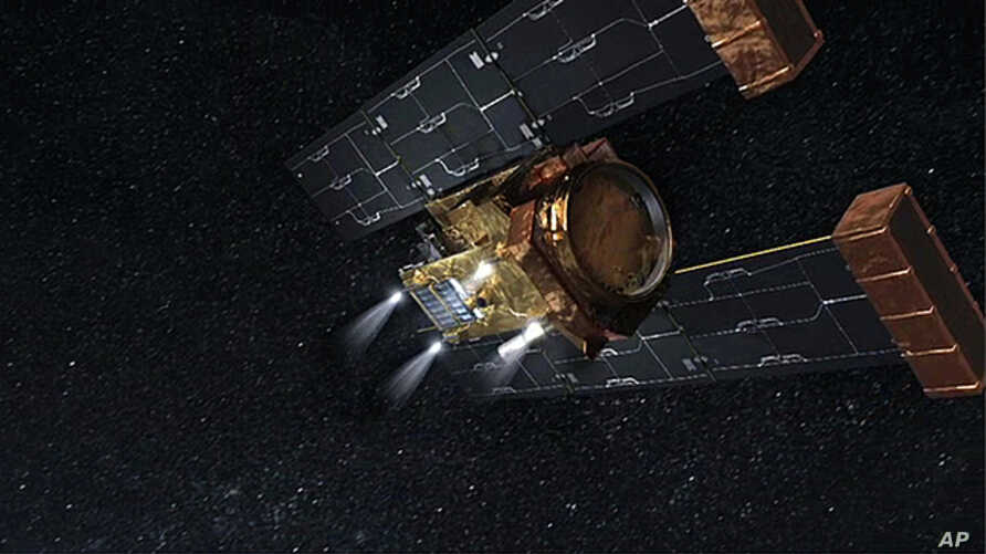 On March 24, at about 2300 UTC, four rocket motors on NASA's Stardust spacecraft, illustrated in this artist's concept, are scheduled to fire until the spacecraft's fuel is depleted.