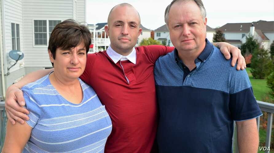 Josh Bell, flanked by his parents, Margaret and Delegate John Bell, in Loudoun County, Va., Nov. 6, 2017, is a recovering opioid addict. He credits his recovery to his family's unfailing love and support.