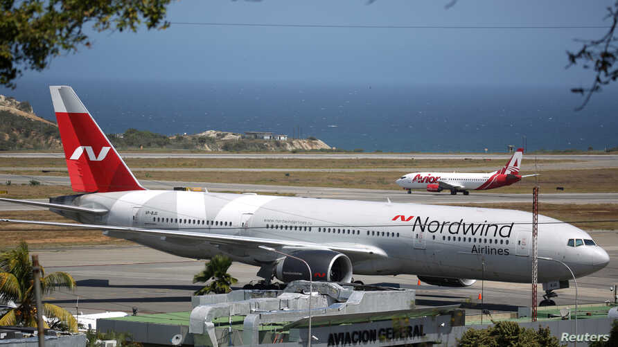A plane from Russian company Nordwind is seen at Simon Bolivar Airport in Caracas, Venezuela, Jan. 29, 2019.