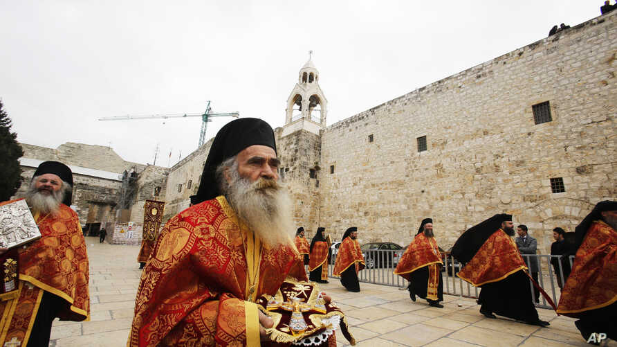 Greek Orthodox priests take part in the Christian Orthodox Christmas Eve celebrations at the Church of the Nativity, traditionally believed by Christians to be the birthplace of Jesus Christ, in the West Bank city of Bethlehem, Jan. 6, 2015.