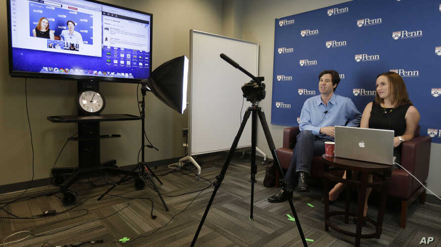 University of Pennsylvania professor Peter Struck and his teaching assistant Cat Gillespie teach a class during a live recording of a massive, open, online class.