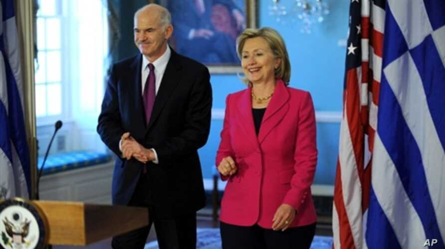 US Secretary of State Hillary Clinton (R) walks with Greek Prime Minister George Papandreou after their bilateral meeting on 8 March 2010 at the State Department in Washington DC.