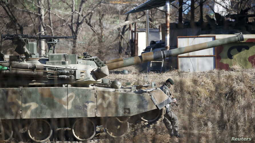 A South Korean soldier takes a rest as he leans on a moblie artillery vehicle at a training field near the demilitarized zone separating the two Koreas in Paju, South Korea, Jan. 7, 2016.