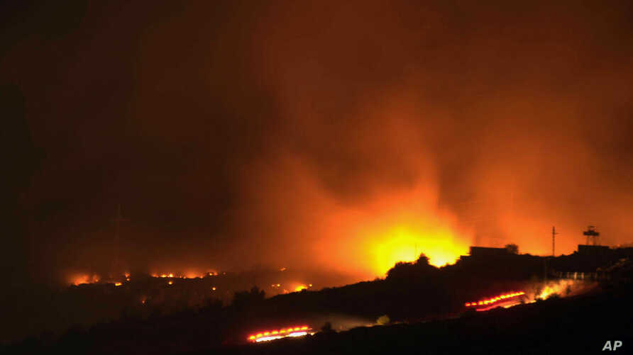 A glow of a large fire seen after an explosion at an ammunition store in Afyonkarahisar in western Turkey, September 6, 2012.