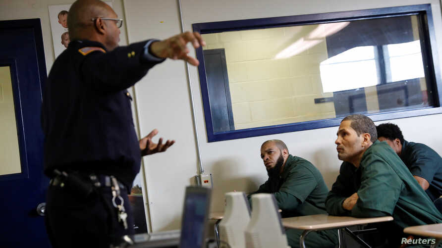 FILE - Inmates Marc Webb (L),34, and Ivan Rodriguez (R),55, listen to Corrections officer Anthony Willingham during a training session on the use of the Naloxone nasal spray, part of an opioid anti-overdose medicine kit for inmates to take with them