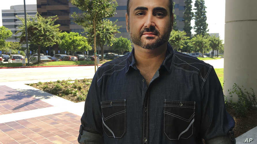 U.S. Navy veteran Mohammed Jahanfar poses for a photo during an interview on Sept. 27, 2017, in Long Beach, Calif. Jahanfar, is seeking a visa to bring his Iranian fiancée to live with him in California, and fears that may not be possible now.