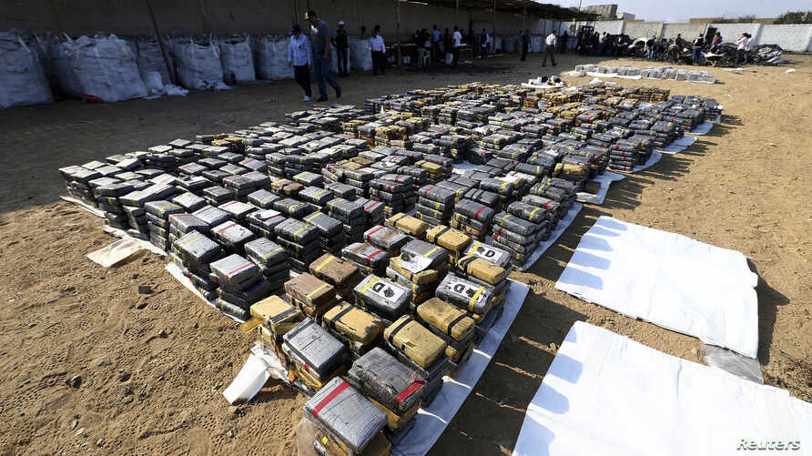 Blocks of confiscated cocaine are seen at a stone coal storage in Trujillo August 26, 2014, in this handout provided by the Peruvian Presidential Palace.
