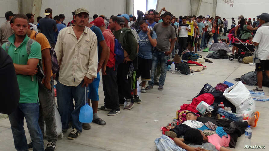 Central American migrants gather before continuing their journey to the U.S. despite President Donald Trump's vow to stamp out illegal immigration, in Ixtepec, Oaxaca, Mexico, March 31, 2018.