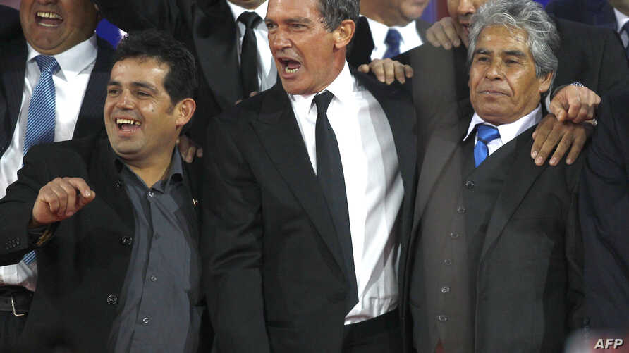 "Actor Antonio Banderas, center, is pictured with Alex Vega, right, and Mario Gomez, two of the 33 workers trapped in a Chilean mine in 2010, at a preview of the film ""The 33"" in Santiago, Chile, August 2, 2015."