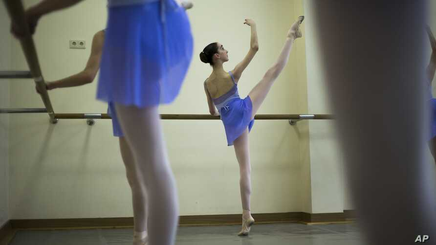 Harper Ortlieb, from Mount Hood, Oregon, performs in a ballet class at the Bolshoi Ballet Academy in Moscow, Russia, March  3, 2016.