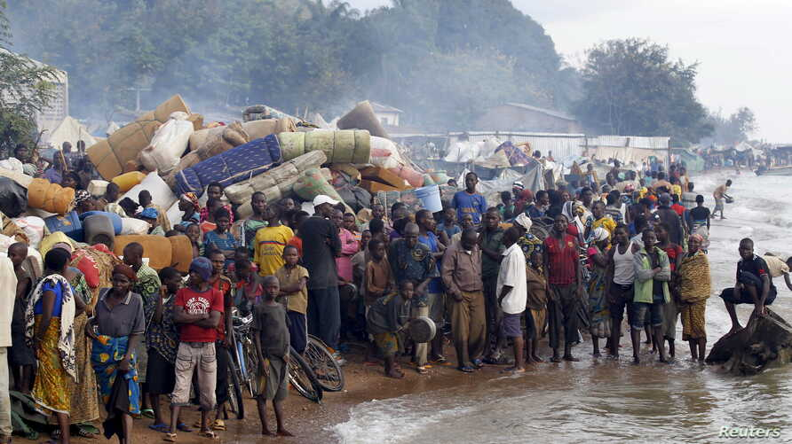 Burundian refugees gather on the shores of Lake Tanganyika in Kagunga village in Kigoma region in western Tanzania, as they wait for MV Liemba to transport them to Kigoma township, May 17, 2015. Burundi President Pierre Nkurunziza on Sunday made his