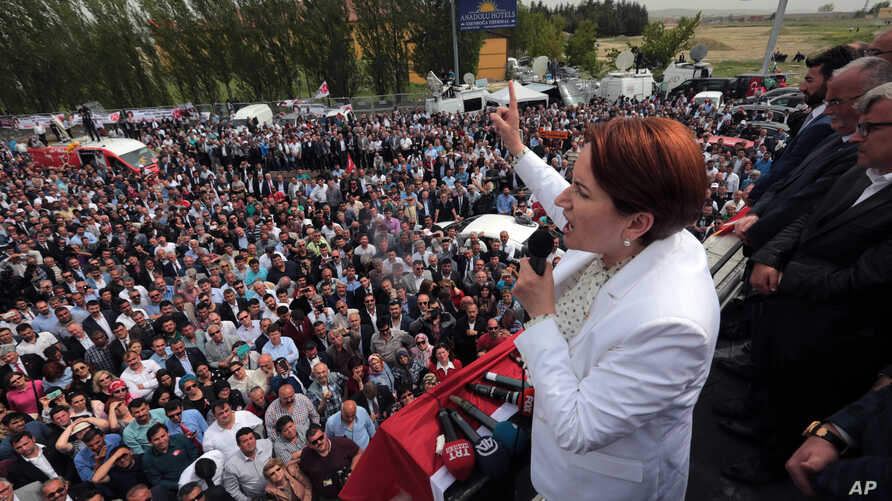 FILE - Meral Aksener, a former Interior minister and the main contester for leadership, addresses supporters as riot police sealed off a hotel to prevent thousands of dissidents in Turkey's opposition Nationalist Movement Party, the MHP, from holding