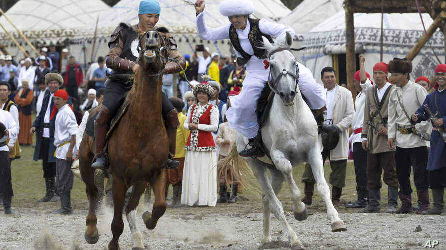 Participants take part in a horse-riding competition during the second World Nomad Games at Issyk Kul lake in Cholpon-Ata, Kyrgyzstan, Sept. 4, 2016.