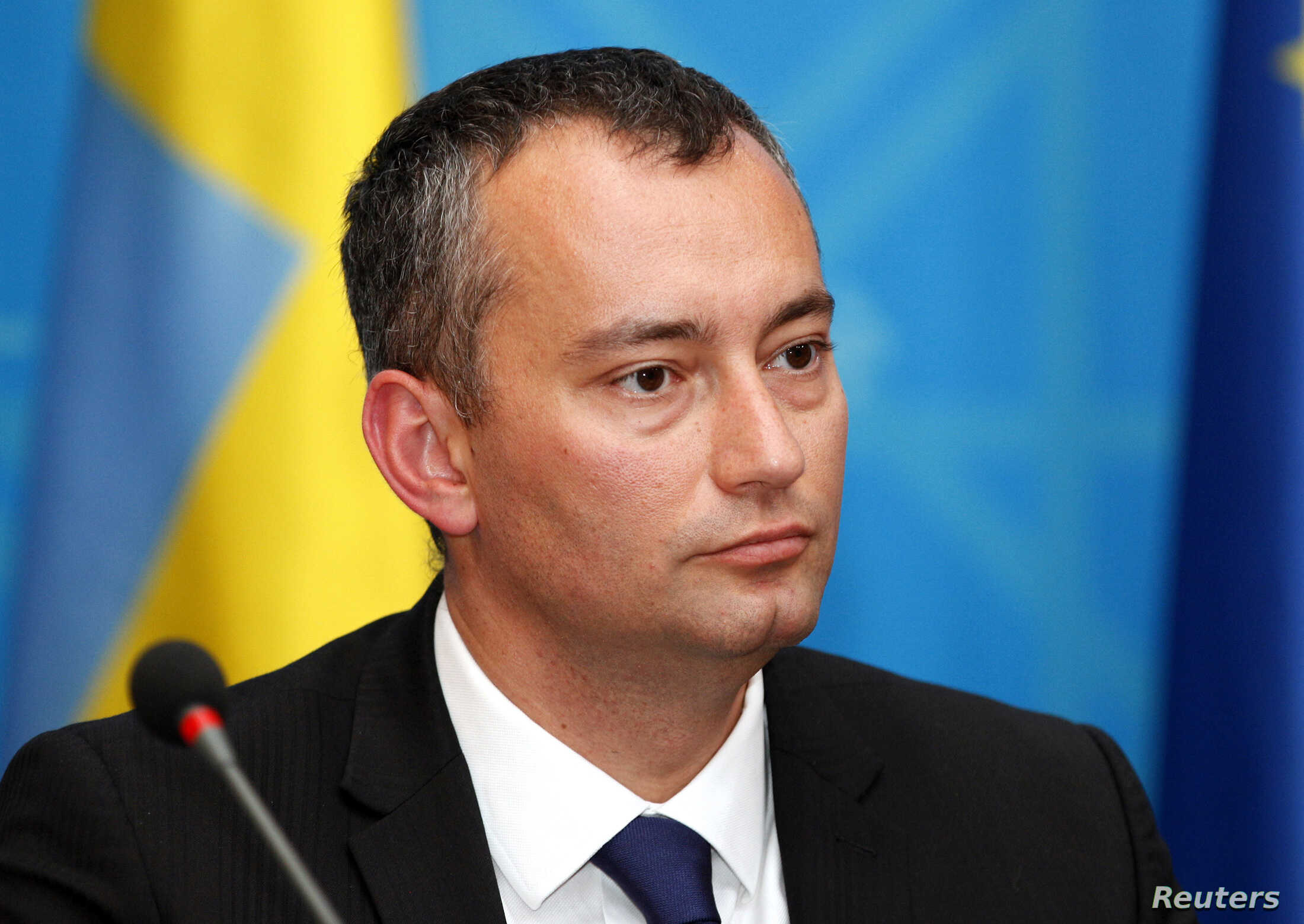 FILE - Special Representative for Iraq Nickolay Mladenov speaks during a joint news conference in the headquarters of the foreign ministry in Baghdad.