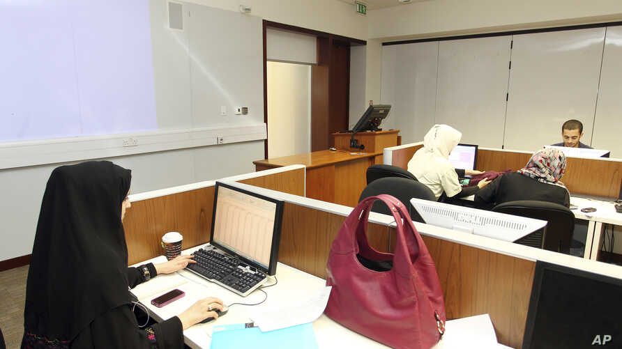 FILE - In 2011 photo, students study at the Texas A&M University located in Education City in Doha, Qatar.